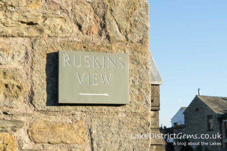 Ruskin's View sign on church