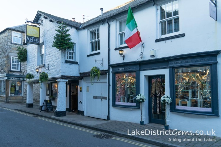 The Sun Inn and neighbouring shops and buildings on Market Street, Kirkby Lonsdale